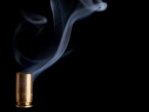 Smoking bullet casing Royalty Free Stock Photo