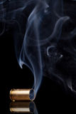 Smoking bullet casing Royalty Free Stock Images