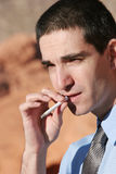 Smoking businessman Royalty Free Stock Image