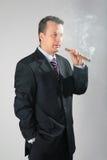 Smoking businessman Stock Photography