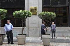 Smoking businessmen Stock Images
