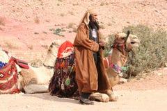 Smoking camel breeder Royalty Free Stock Photography