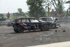 Demolition derby. Napierville demolition derby, July 12, 2015, picture of wrecked and smoking car during the demolition derby stock photography