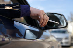 Smoking in car Royalty Free Stock Image