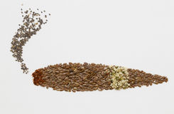 Smoking chia heap and flax seeds sigar Royalty Free Stock Image