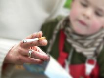 Smoking with children Stock Photography