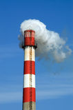 Smoking Chimney. Blue sky chimney environment in danger smoke exhaust ecology industrial climate pollution Royalty Free Stock Images