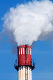Smoking Chimney. Blue sky chimney environment in danger smoke exhaust ecology industrial climate pollution Royalty Free Stock Photo