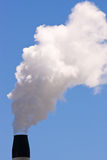 A smoking chimney Stock Photo
