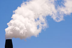 A smoking chimney Stock Photos