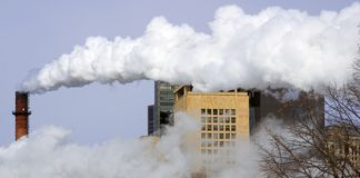 Smoking Chimney and City Buildings Stock Images
