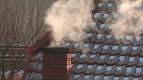 Smoking Chimney on a Roof stock video footage