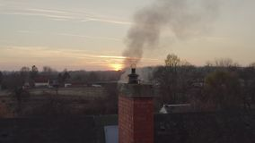 Smoking Chimney on a Roof stock footage