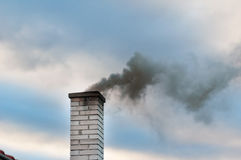 Smoking chimney smoke pollution, small house town Royalty Free Stock Photography