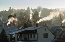 Smoking chimney smoke pollution, small house town stock photography