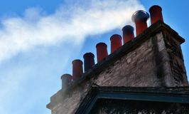 Smoking chimney stack on house Royalty Free Stock Photos