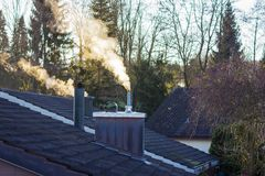 Smoking chimney in sunny morning Stock Photography