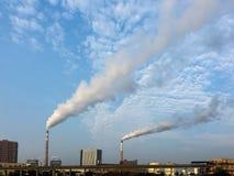 A smoking chimney stock photography
