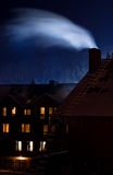 Smoking chimney in the winter night Stock Photos