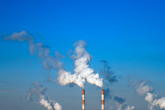 Smoking chimneys Stock Images