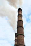 Smoking chimneys. Chimneys smoke into the atmosphere Royalty Free Stock Photography