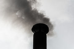 Smoking chimneys of black smoke Royalty Free Stock Photo