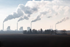 Smoking Chimneys of a Coal Fired Power Plant Royalty Free Stock Images