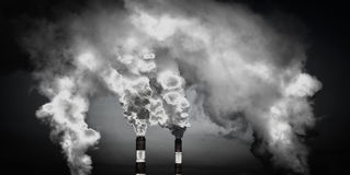 Smoking chimneys. Environmental issues. The destruction of the ozone layer Stock Photo