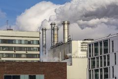 The Smoking chimneys of factories and office buildings manufacturing royalty free stock photo