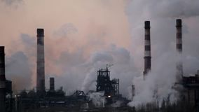 Smoking chimneys of a factory in the industrial area of city stock video