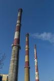 Smoking chimneys heat Stock Photography