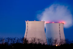 Smoking chimneys of an industrial power plant. At night stock photography