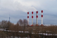 Smoking chimneys and Ostankino TV Tower in winter 2016. Ecology in Moscow near the TV tower stock photos