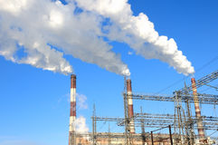 Smoking chimneys of power plant Royalty Free Stock Photos