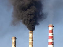 Smoking chimneys of power station Stock Photos