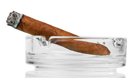 Smoking cigar in an ashtray. Isolated on white Royalty Free Stock Image