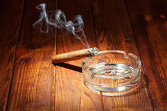 Smoking cigar in an ashtray Stock Photography