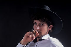 Smoking cigar portrait with hat Royalty Free Stock Images