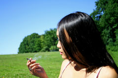 Smoking a cigarette Stock Images