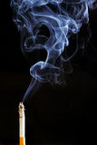 Smoking cigarette. Isolated on black Stock Photography