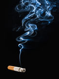 Smoking Cigarette. Cigarette with Filter and Ash, Smoking on Dark Background Stock Images