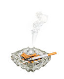 Smoking cigarette in ashtray Stock Image