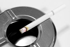 Smoking cigarette in ashtray Stock Images