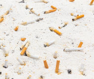 Smoking cigarette in ashtray Royalty Free Stock Image