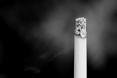Smoking cigarette desaturated. Royalty Free Stock Photos