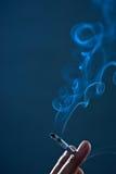Smoking a cigarette Royalty Free Stock Photo