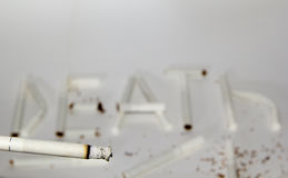 Smoking cigarette and inscription death Royalty Free Stock Photo
