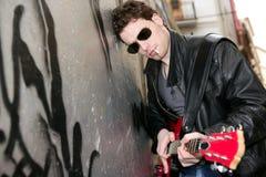 Smoking cigarette rock leather boy playing guitar Royalty Free Stock Photos