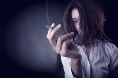 Smoking cigarette Stock Photos