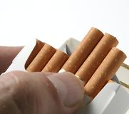 Smoking of cigarettes Stock Images